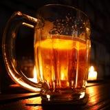 Beer in dark Stock Images