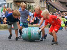 Barrel rolling race. Beer, Devon, UK.14th August 2018: Famous barrel rolling race in main street of Beer during annual Beer Regatta Week event. Four members of