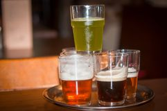 Beer of different colors in glasses. Glasses with different sorts of craft beer Stock Image