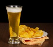 Beer and dish with chips Stock Image