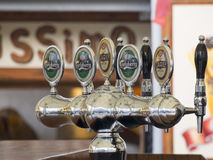 Beer dispenser at a bar Stock Image