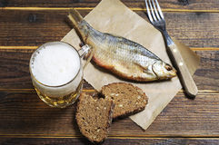 Beer and dried fish Stock Photos