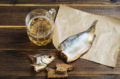 Beer and dried fish Stock Photography