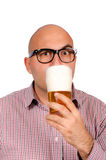 Beer drinker. Bald man drinking the glass of beer Royalty Free Stock Photos