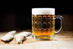 Beer with dry salty fish Stock Images