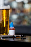 Beer, e-juice and personal vaporizer Royalty Free Stock Photos
