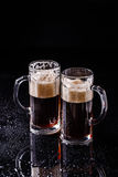 Beer on empty black table Stock Photography