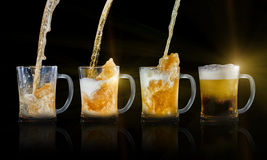 Beer evolution. On four glasses Stock Photos