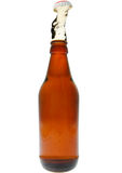 Beer explosion. Beer bottle with beer exploding out of the top isolated on white Stock Photography