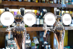 Beer faucets in a bar Royalty Free Stock Photography