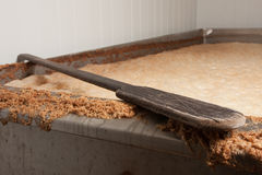Beer fermentation and a mixing spatula Royalty Free Stock Photo