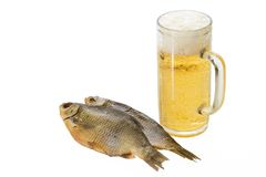 Beer and fish. Mug with beer and dried fishes Royalty Free Stock Image