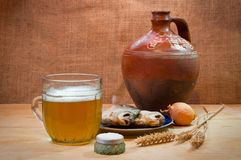 Beer, fish and jug. Still life Royalty Free Stock Photo