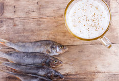 Beer and fish on the table top view background Stock Photos