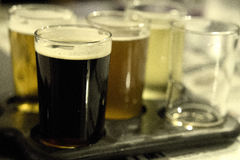 Beer flight sampler at nice restaurant royalty free stock images
