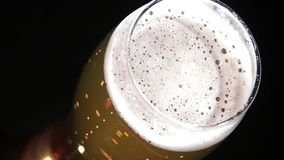 Beer flow in a glass stock footage