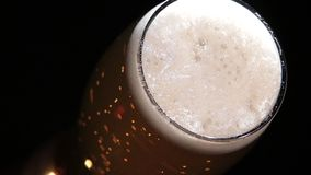 Beer flow in a glass stock video footage
