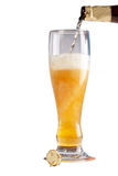Beer flowing in the glass Royalty Free Stock Images