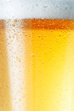 Beer an Foam. Close-up picture of a condensation on the glass of beer Stock Photos