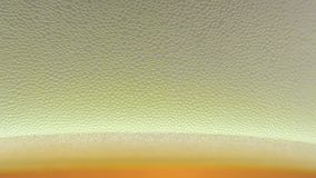 Beer foam. Shot macro visible large bubbles stock footage