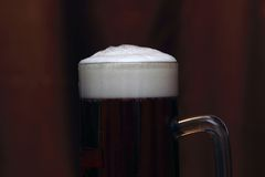 Beer with foam. Close Up photo of beer with foam royalty free stock images
