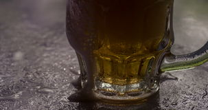 Beer Foam Flows Down on a Mug