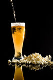 Beer with foam and popcorn Royalty Free Stock Images