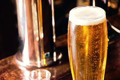 Beer. Fresh gold and cold beer in the glass in the bar. Alcohol in the bar Stock Photo