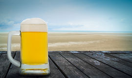 Beer in front the sea Stock Photography
