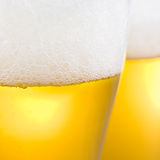 Beer with froth. Close up of beer with froth stock photo