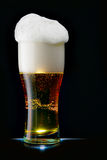 Beer with froth. Glass of beer with froth over black background stock photography