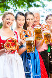 Beer garden - friends drinking in Bavaria Pub Royalty Free Stock Image