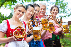 Beer garden - friends drinking in Bavaria Pub Royalty Free Stock Images