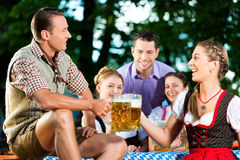In Beer garden - friends drinking beer Stock Image