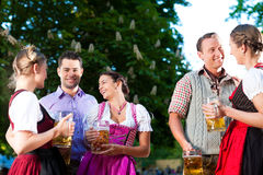 In Beer garden - friends drinking beer Royalty Free Stock Photography