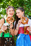 In Beer garden - friends drinking beer in bavaria Stock Images