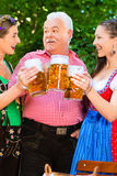 In Beer garden - friends drinking beer in bavaria Royalty Free Stock Images