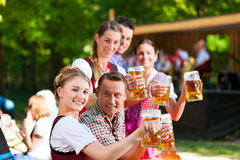 In Beer garden - friends in front of band Royalty Free Stock Photo