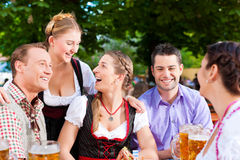 In Beer garden - friends on a table with beer Royalty Free Stock Photography