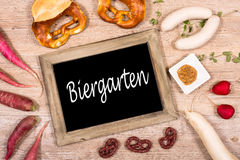 Free Beer Garden Sign With Sausages, Radishes And Pretzel Royalty Free Stock Photos - 44284778