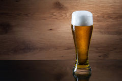 Beer. Gass of beer on wooden background with copyspace Stock Photography