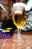 Beer glass. A beer glass on a bar counter royalty free stock image