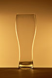 Beer glass. Empty beer glass on a surface, back-lit Royalty Free Stock Images