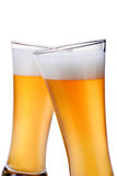 Beer into glass. Beer glass glass over a white background Stock Image