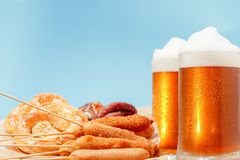 Beer glass alcohol drink with food sausage,  meal pretzel royalty free stock photography