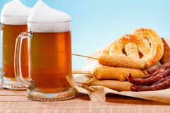 Beer glass alcohol drink with food sausage,  pub royalty free stock photo