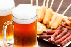 Beer glass alcohol drink with food sausage,  snack bar royalty free stock photos