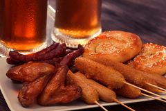 Beer glass alcohol drink with food sausage,  snack board royalty free stock photography