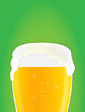 Beer glass background. Glass of beer with bubbles and foam on a green background ideal for magazines, plenty room for headline and text, maybe a commercial Royalty Free Stock Photos
