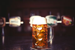 Beer glass on a bar table. Closeup Stock Image
